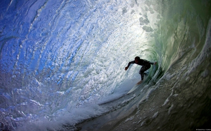 Surfer riding a tube